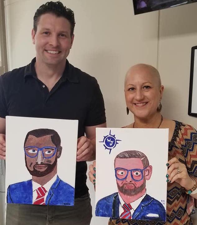Brock Allen (left) and Alice DeGeorge (right) paint portraits of Attorney Adam Williams.